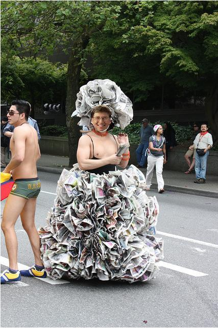 This photo of Bill Gates in a newspaper dress is sure to get me a free, all-expense paid trip from Seattle to Redmond.