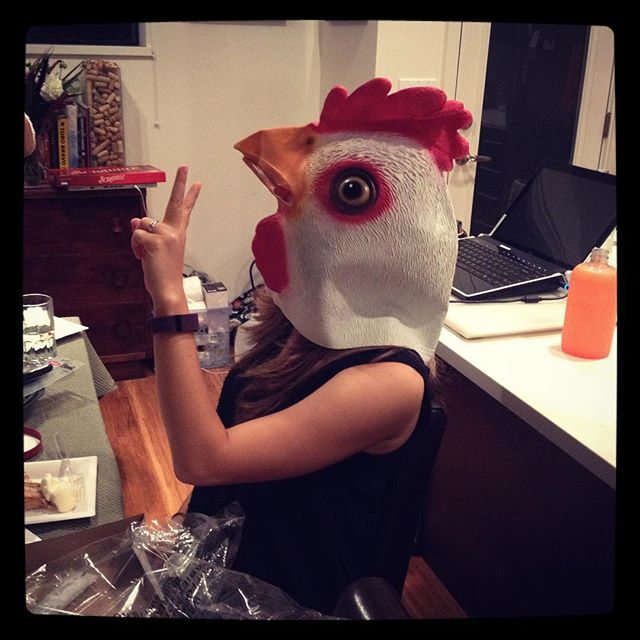 Me on my birthday. Photo courtesy of my friend Chrissy. Chicken head courtesy of my cousin Marco.
